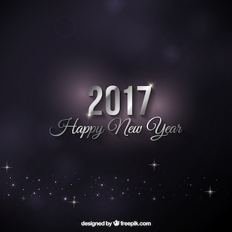 Dark background with silver lettering of new year