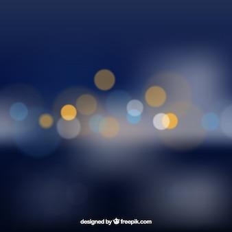 Sfondo blu scuro con effetto bokeh Vettore gratuito