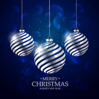 Dark blue background with silver christmas balls and bokeh effect