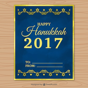 Dark blue hanukkah greeting card with golden frame