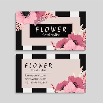 Dark business card with beautiful pink flowers