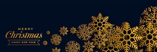 Banner di natale scuro con fiocchi di neve dorati
