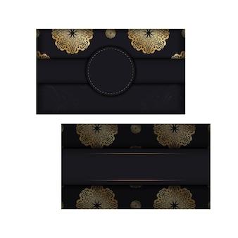 Брошюра темного цвета с роскошным золотым орнаментом
