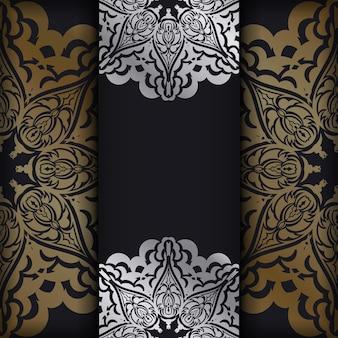 Карточка темного цвета с золотым индийским узором