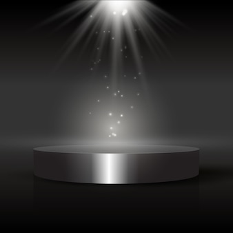 Dark display background with podium under spotlight