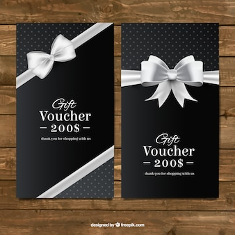 Dark gift coupons with a silver bow