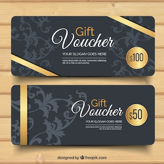 Dark gift vouchers with golden ribbon