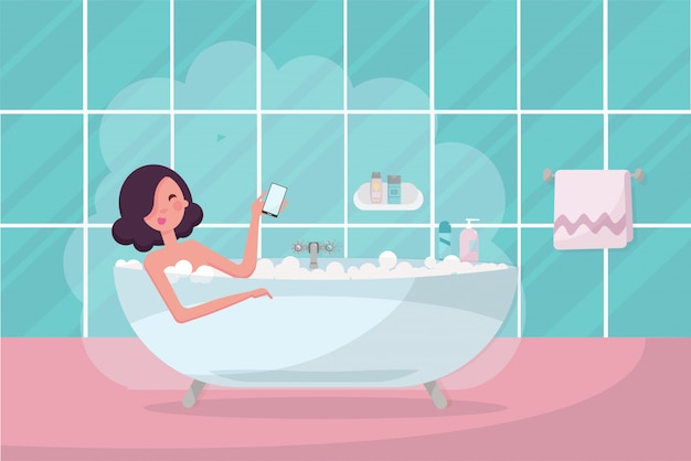 Dark hair girl in bathtub with smartphone in her hand.