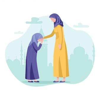 ハリラヤaidilfitriのお祝い中に許しを求める娘と母
