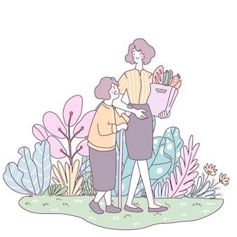 La figlia ha portato la madre più anziana a fare la spesa per comprare la verdura.