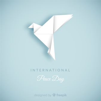 Day of peace composition with origami white dove