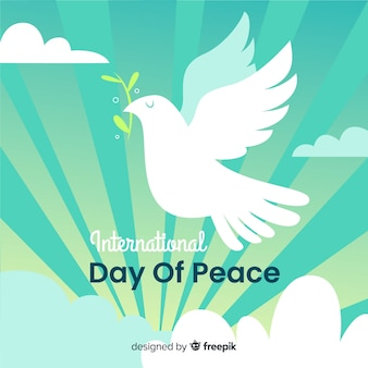 Day of peace with dove and sun rays