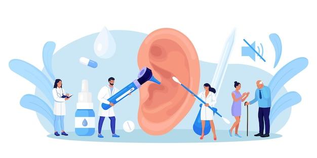 난청, 청력 상실. 의사는 귀, 청각 기관의 건강을 확인합니다. 청각 문제가 있는 청각 장애 환자는 치료를 위해 청각 전문의를 방문합니다. 건강 검진, 귀 검사. 보청기가 있는 큰 귀