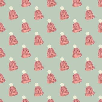 ピンクの暖かい帽子の飾りと12月のシームレスなアクセサリーパターン。パステルカラーの背景。テキスタイル、ファブリック、ギフトラップ、壁紙用のフラットベクタープリント。無限のイラスト。