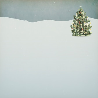 A decorated christmas tree on a snowy land background