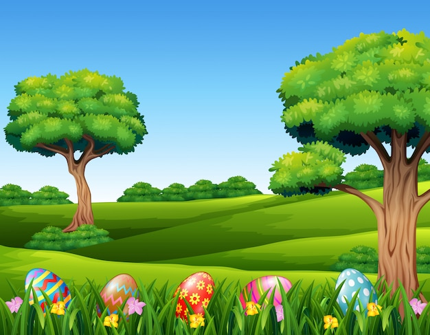 Decorative easter eggs on the meadow in the nature