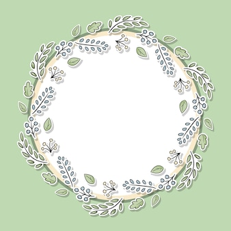 Decorative floral frame with green leaves and branches.