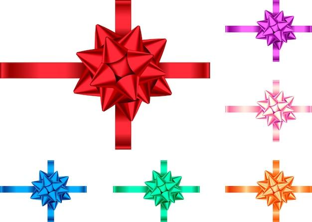白い背景で隔離の装飾的なギフトリボンと弓。休日の装飾。バナー、グリーティングカード、ポスターの装飾要素のベクトルセット。