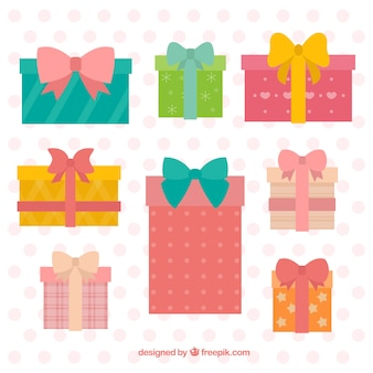 Decorative gifts with bows in flat design