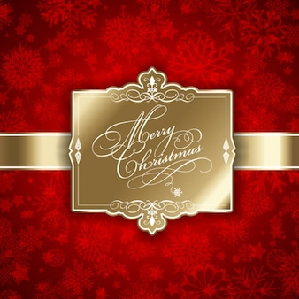 Decorative golden christmas tag on a red background