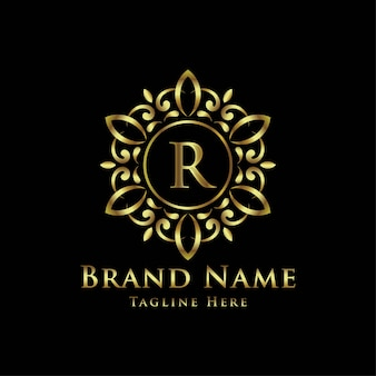 イニシャル付きの装飾的な金色の曼荼羅のロゴ
