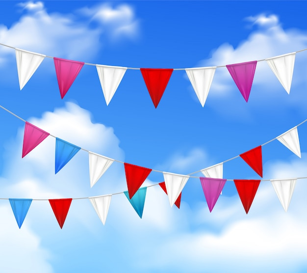 Decorative outdoor party slingers pennants red white pink against blue cloudy sky realistic closeup image