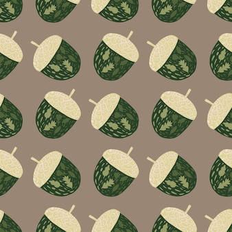 シンプルな緑のどんぐりのシルエットで装飾的なシームレスパターン