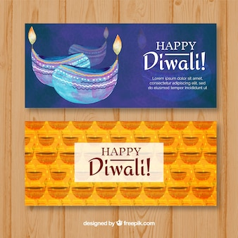 Decorative watercolor banners with diwali candles