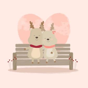 공원에서 벤치에 앉아 석양을 감상하는 사슴 부부