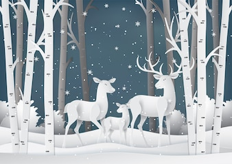 Deer family in the forest with snow.