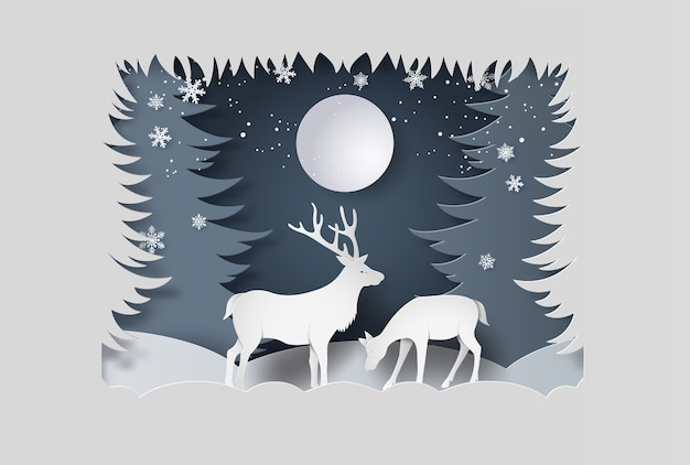 Deer in forest with snow. paper art style.