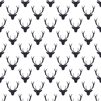 Deer head pattern. wild animal symbols seamless background. silhouette monochrome design