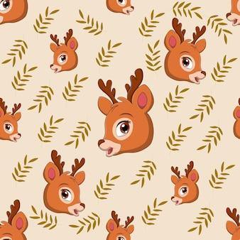 葉と鹿の頭のシームレスなパターン