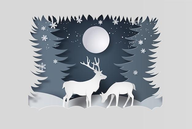 雪の森の鹿。紙のアートスタイル。