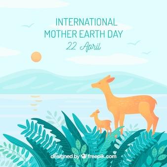 森の中のdeersとの国際的な母の地球の日の背景