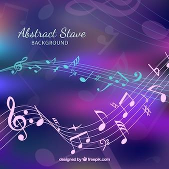 Расфокусированный фиолетовый фон с музыкальными нотами и пентаграммой