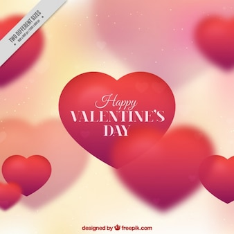 Defocused valentine background with red hearts