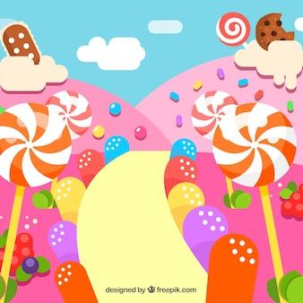 平面スタイルのおいしいキャンディー土地の背景