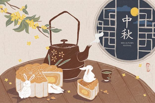 중순 가을 축제를 위해 나무 원형 테이블에 맛있는 월병과 뜨거운 차