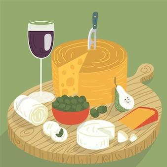 Delizioso spuntino di formaggio sul tagliere con vino