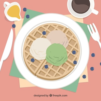 Delicious waffle with ice-cream in a top view