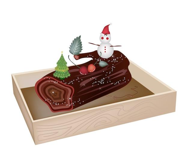 나무 용기에 맛있는 성탄절 로그 케이크