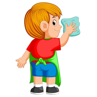 Деликатный мальчик делает ежедневную деятельность по очистке синим полотенцем