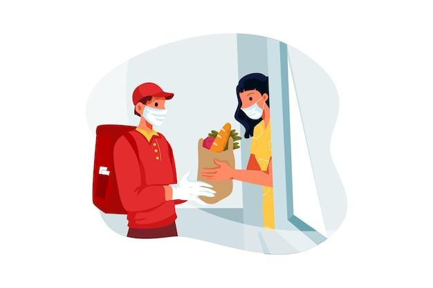 受取人に生鮮食品を渡す配達人