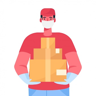 A delivery man in protective medical face mask and gloves holds a cardboard boxes in his hands