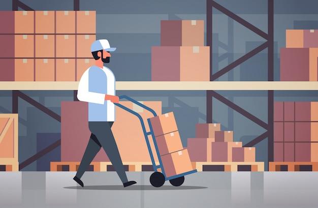 Delivery man rolling cardboard box cargo trolley