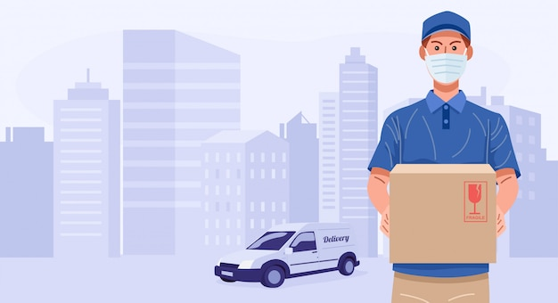 Delivery man wearing face mask holding parcel,