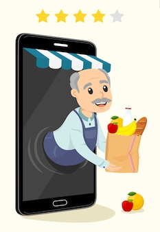 Delivery old man with pantry coming out of a cellphone