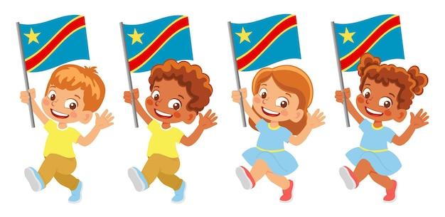 Флаг демократической республики конго в руке. дети держат флаг. государственный флаг демократической республики конго