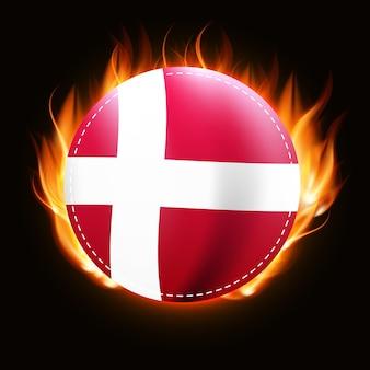 デンマークの国旗に火が付いている国章